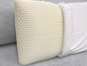 latez foam pillow with cover half on